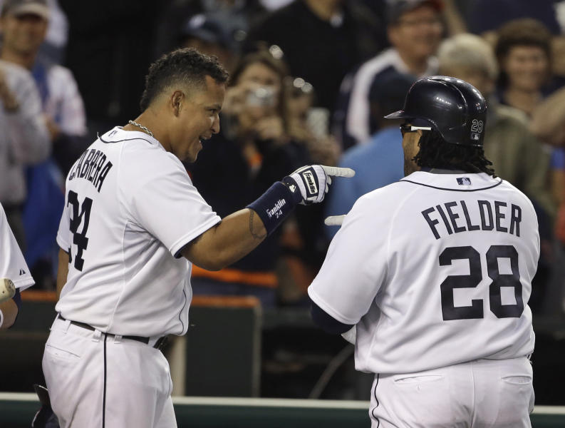 Detroit Tigers' Miguel Cabrera, left, points to teammate Prince Fielder after Fielder's two-run home run during the fifth inning of a baseball game against the Minnesota Twins in Detroit, Tuesday, April 30, 2013. (AP Photo/Carlos Osorio)