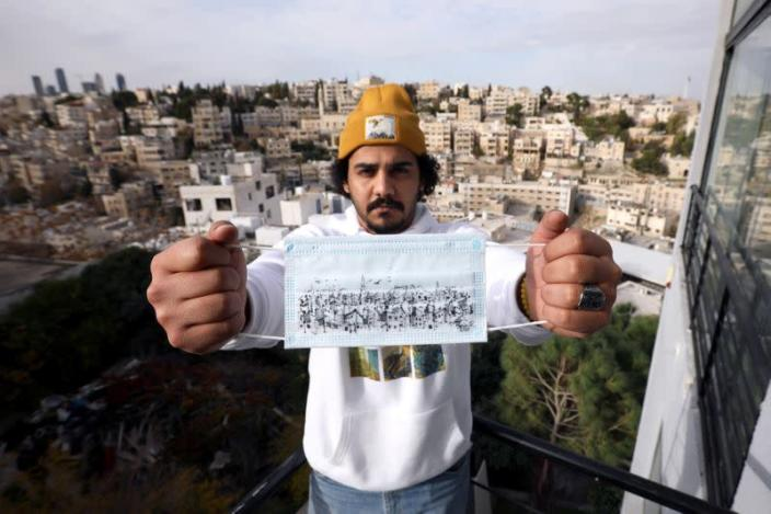 FILE PHOTO: Jordanian artist paints protective masks to highlight their importance in Amman