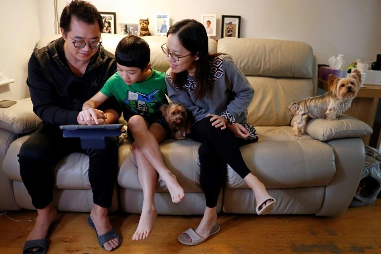 An assault on Hong Kong's pro-democracy protesters drove Winston Wong and Connie Chan to move to Britain with their son Cheston