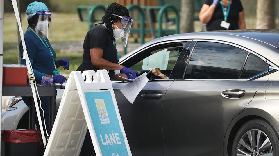 A healthcare worker with the Florida Department of Health in Broward prepares to administer a COVID-19 vaccine at a drive-thru vaccination site at Vista View Park on January 04, 2021 in Davie, Florida. (Joe Raedle/Getty Images)