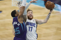 Orlando Magic forward Ignas Brazdeikis, right, shoots against Charlotte Hornets forward P.J. Washington during the second half of an NBA basketball game in Charlotte, N.C., Friday, May 7, 2021. (AP Photo/Nell Redmond)