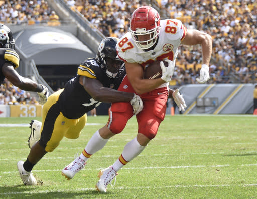 FILE - In this Sept. 16, 2018, file photo, Kansas City Chiefs tight end Travis Kelce (87) tries to get away from Pittsburgh Steelers linebacker Vince Williams during an NFL football game in Pittsburgh. The Chiefs play the Denver Broncos on Monday night. Kelce had a 133-yard game against the Broncos last year. (AP Photo/Don Wright, File)