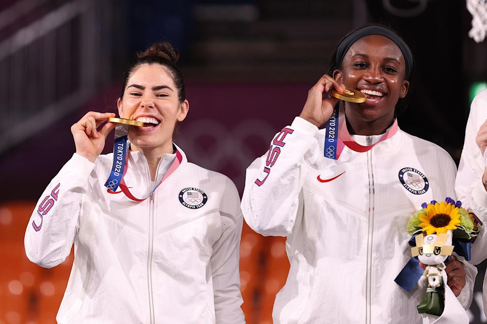 TOKYO, JAPAN - JULY 28: Gold medalists Kelsey Plum and Jacquelyn Young of Team United States pose on the podium during the medal ceremony for the 3x3 Basketball competition on day five of the Tokyo 2020 Olympic Games at Aomi Urban Sports Park on July 28, 2021 in Tokyo, Japan. (Photo by Christian Petersen/Getty Images)