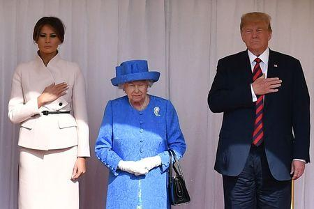 FILE PHOTO: U.S. President Donald Trump and First Lady Melania Trump stand with Britain's Queen Elizabeth on the dais during the U.S. national anthem in the Quadrangle at Windsor Castle, Windsor