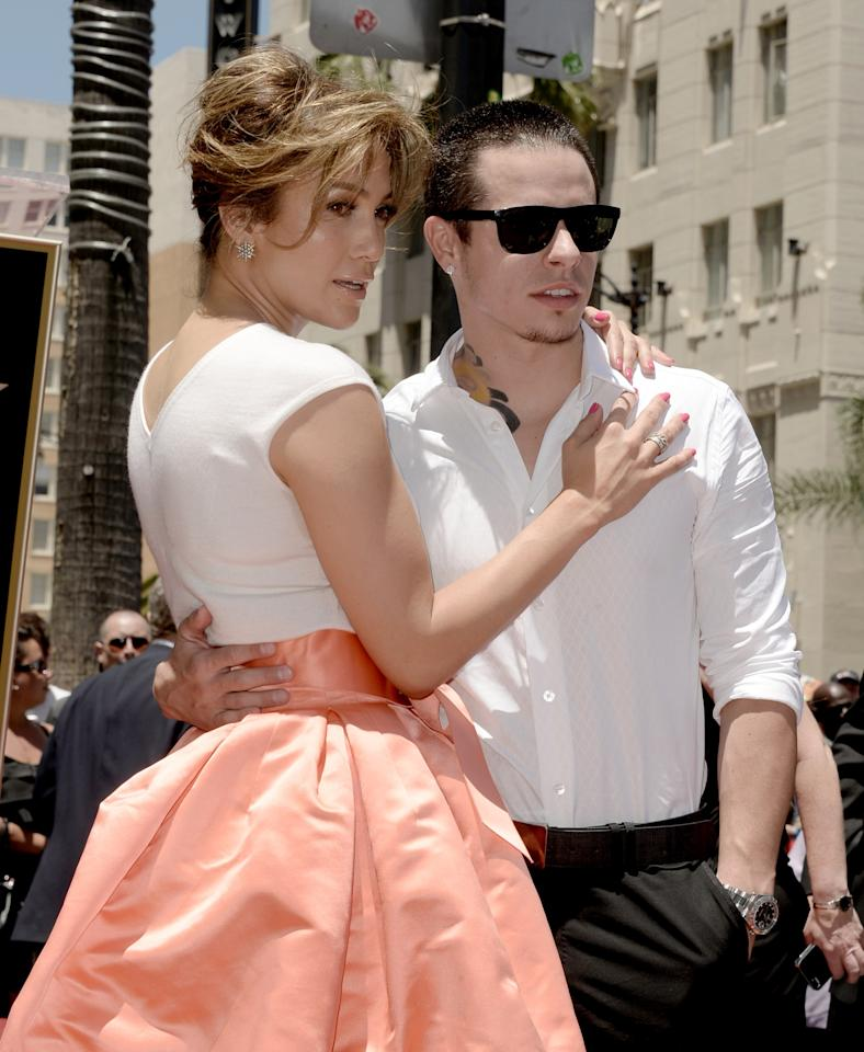 HOLLYWOOD, CA - JUNE 20: Actress/singer Jennifer Lopez (L), with her boyfriend Casper Smart, is honored with the 2500th star on the Hollywood Walk of Fame on June 20, 2013 in Los Angeles, California. (Photo by Kevin Winter/Getty Images)