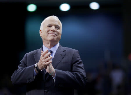 FILE PHOTO: John McCain listens as he is introduced at a campaign rally in Fayetteville, North Carolina, October 2008 (REUTERS/Brian Snyder)