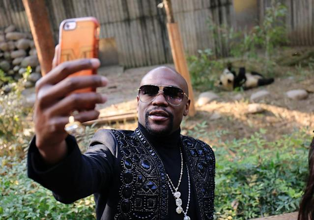 US boxer Floyd Mayweather's donation allows him to visit the panda and have it called by the name he wishes for a year (AFP Photo/-)