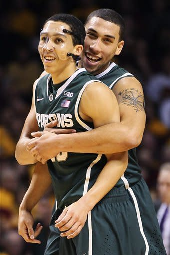 Michigan State guard Travis Trice, left, is congratulated by Denzel Valentine after a foul call against Minnesota in the first half of their NCAA college basketball game, Monday, Dec. 31, 2012, in Minneapolis. (AP Photo/Andy Clayton King)