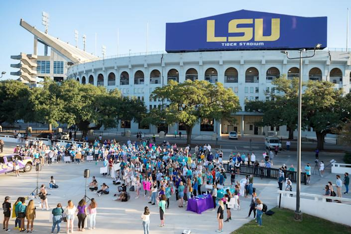 Protesters march on the LSU campus Nov. 20, 2020, in reaction to the way officials handled rape and abuse allegations against football players.