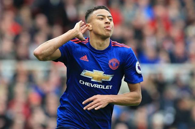 Manchester United's Jesse Lingard, pictured in March 2017, signed a new deal with the team that will pay him £100,000-a-week till 2021 (AFP Photo/Lindsey PARNABY)