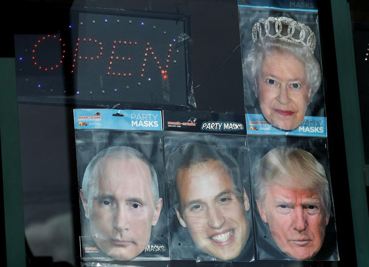 Cardboard facemasks of Britain's Queen Elizabeth, Prince William, Donald Trump and Vladimir Putin are seen for sale at a shop in central London, March 14, 2018. REUTERS/Phil Noble