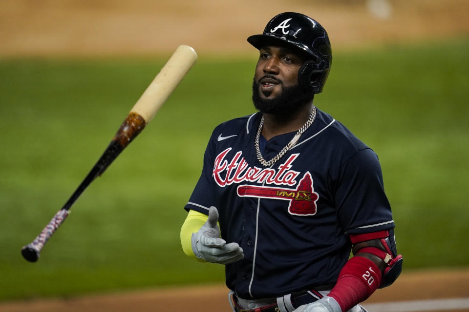 ARLINGTON, TX - OCTOBER 18:  Marcell Ozuna #20 of the Atlanta Braves walks to the dugout after being robbed of a home run during Game 7 of the NLCS between the Atlanta Braves and the Los Angeles Dodgers at Globe Life Field on Sunday, October 18, 2020 in Arlington, Texas. (Photo by Cooper Neill/MLB Photos via Getty Images)