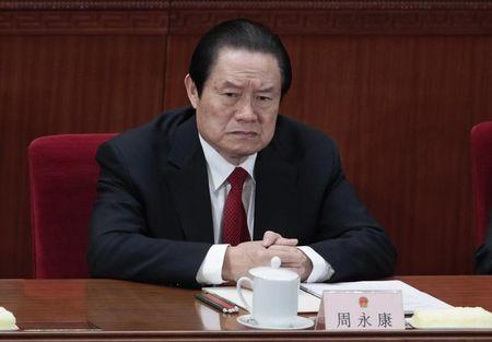 China's former Politburo Standing Committee Member Zhou Yongkang attends the closing ceremony of the NPC in Beijing