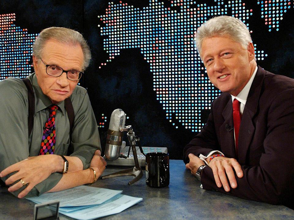 Ex-president Bill Clinton with King on CNN in 2002Reuters