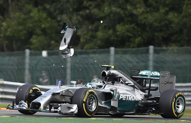 A piece of wing flys over the Mercedes-AMG of German driver Nico Rosberg after a collision with teammate and British driver Lewis Hamilton in Spa on August 24, 2014 during the Belgium Formula One Grand Prix (AFP Photo/John Thys)