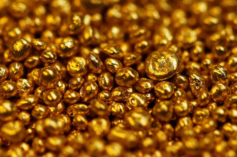 FILE PHOTO: Gold granulate is seen at a plant of gold refiner and bar manufacturer Valcambi SA in the southern Swiss town of Balerna