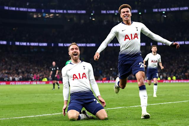 Christian Eriksen of Tottenham Hotspur celebrates with teammate Dele Alli after scoring his team's first goal during the Premier League match between Tottenham Hotspur and Brighton & Hove Albion