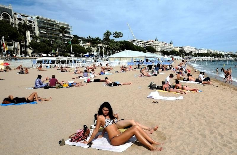 Evidence suggests men are less likely to protect themselves from the sun or heed public health warnings, researchers said (AFP Photo/ALBERTO PIZZOLI)