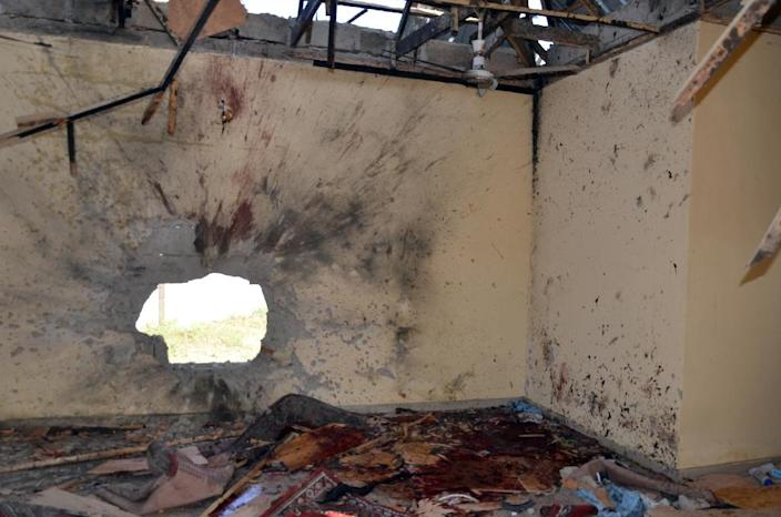 A picture taken on October 23, 2015 in Maiduguri, northeast Nigeria, shows a hole on the wall following a suicide bombing at a mosque (AFP Photo/)