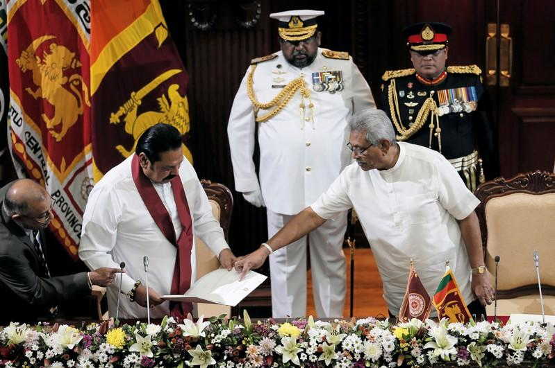 Sri Lanka's President Gotabaya Rajapaksa and his brother and former leader Mahinda Rajapaksa, who was appointed as the new Prime Minister, are seen during the swearing in ceremony in Colombo