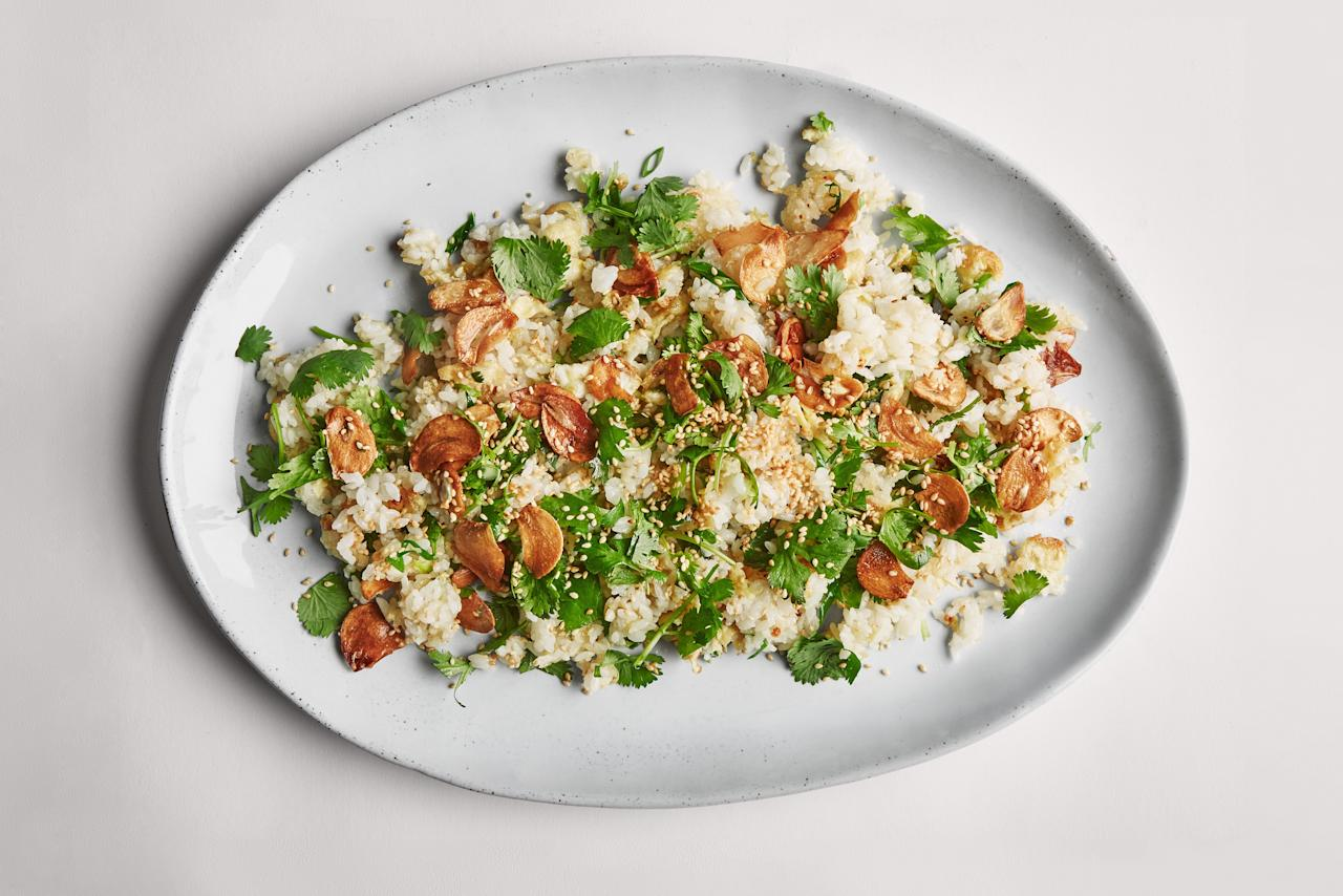 """Bronze garlic chips in vegetable oil, then use the fragrant oil to stir-fry cooked rice. Top with fresh herbs, those crispy garlic chips, and—if you'd like—a fried egg. <a href=""""https://www.epicurious.com/recipes/food/views/the-garlickiest-fried-rice?mbid=synd_yahoo_rss"""">See recipe.</a>"""