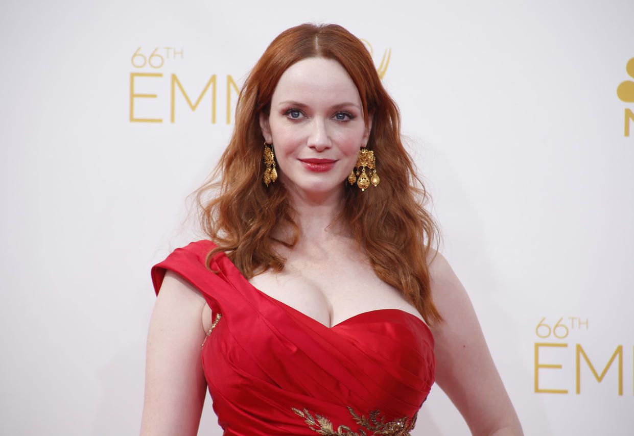 Christina Hendricks, here at the 2014 Emmy Awards, opens up about sexual harassment, Mad Men and more.