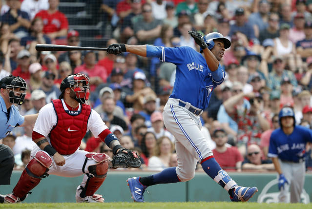 Toronto Blue Jays' Curtis Granderson follows through on a hit against the Boston Red Sox in a baseball game Saturday, July 14, 2018, in Boston. (AP Photo/Winslow Townson)
