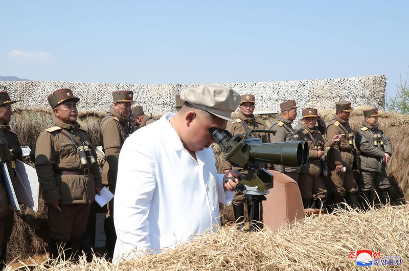 North Korean leader Kim Jong Un guides a drill of mortar sub-units of North Korean Army