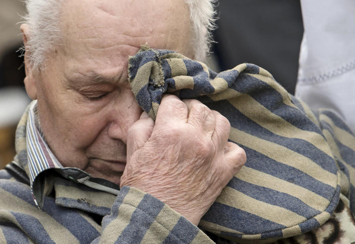 <p>Nazi concentration camp survivor Petro Fedorowitsch Mischuk of Ukraine holds his uniform cap in front of his face during the commemoration ceremonies for the 72th anniversary of the liberation of former Nazi concentration camp Mittelbau-Dora near Nordhausen, central Germany, Monday, April 10, 2017. (Photo: Jens Meyer/AP) </p>
