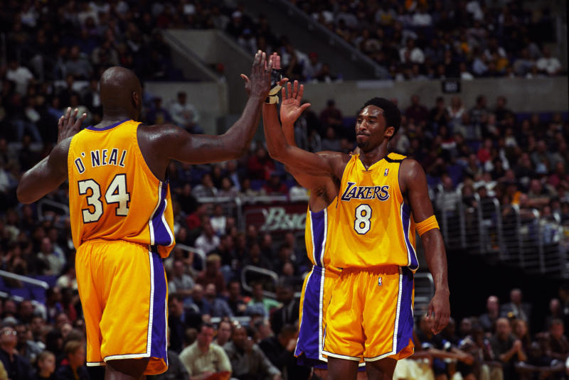 FILE: Shaquille O'Neal and Kobe Bryant of the Los Angeles Lakers high five each other during a National Basketball Association game against the Orlando Magic at the Great Western Forum in Los Angeles, CA. (Photo by Matt A. Brown/Icon Sportswire via Getty Images)