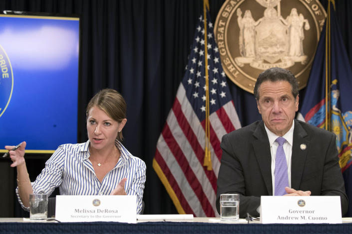 FILE — In this Sept. 14, 2018 file photo, Secretary to the Governor Melissa DeRosa, is joined by New York Gov. Andrew Cuomo as she speaks to reporters during a news conference, in New York. Top aides to Cuomo altered a state Health Department report to obscure the true number of people killed by COVID-19 in the state's nursing homes, The Wall Street Journal and The New York Times reported late Thursday, March 4, 2021. The aides, including DeRosa, pushed state health officials to edit the July report so only residents who died inside long-term care facilities, and not those who became ill there and later died at a hospital, were counted, the newspapers reported.(AP Photo/Mary Altaffer, File)