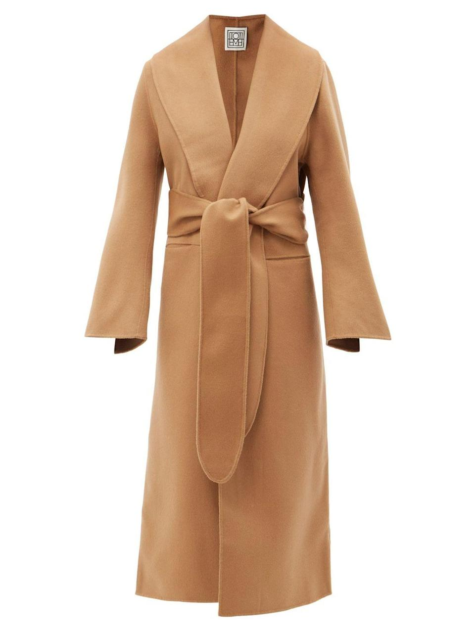 """<p><a class=""""link rapid-noclick-resp"""" href=""""https://www.matchesfashion.com/products/Tot%C3%AAme-Flared-sleeve-belted-wool-coat-1434677"""" rel=""""nofollow noopener"""" target=""""_blank"""" data-ylk=""""slk:SHOP NOW"""">SHOP NOW </a></p><p>The appeal of the wrap coat is in its relaxed luxury, so the more similarities to a robe the better. With extra-wide sash belt, flared sleeves and striking shawl lapels, Totême's is perfect.</p><p>Flared-sleeve Belted Wool Coat, £800, Totême</p>"""