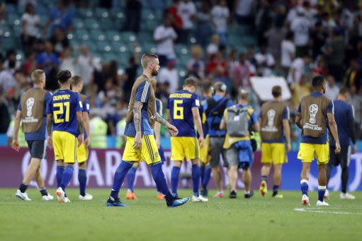 Sweden players walk on the pitch at the end of the group F match between Germany and Sweden at the 2018 soccer World Cup in the Fisht Stadium in Sochi, Russia, Saturday, June 23, 2018. Germany won 2-1.(AP Photo/Frank Augstein)