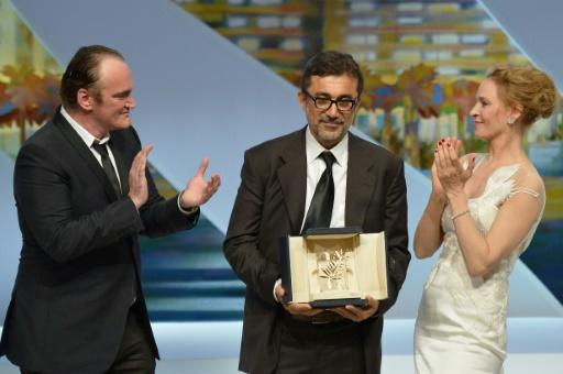 Ceylan receives his 2014 Palme D'Or from US director Quentin Tarantino and US actress Uma Thurman