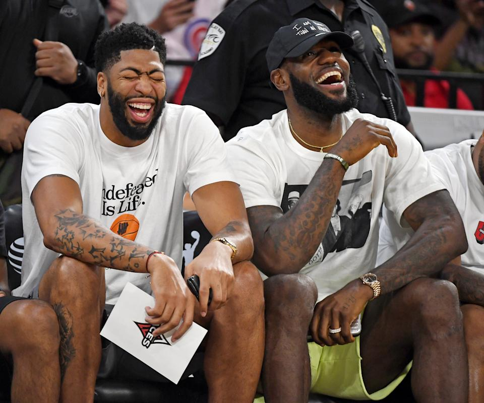 LAS VEGAS, NEVADA - SEPTEMBER 24:  Anthony Davis (L) and LeBron James of the Los Angeles Lakers laugh while attending Game Four of the 2019 WNBA Playoff semifinals between the Washington Mystics and the Las Vegas Aces at the Mandalay Bay Events Center on September 24, 2019 in Las Vegas, Nevada. The Mystics defeated the Aces 94-90 and won the series 3-1. NOTE TO USER: User expressly acknowledges and agrees that, by downloading and or using this photograph, User is consenting to the terms and conditions of the Getty Images License Agreement.  (Photo by Ethan Miller/Getty Images)