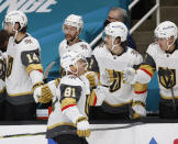 Vegas Golden Knights center Jonathan Marchessault (81) celebrates with the bench after scoring a goal against the San Jose Sharks during the first period of an NHL hockey game in San Jose, Calif., Saturday, Feb. 13, 2021. (AP Photo/Josie Lepe)