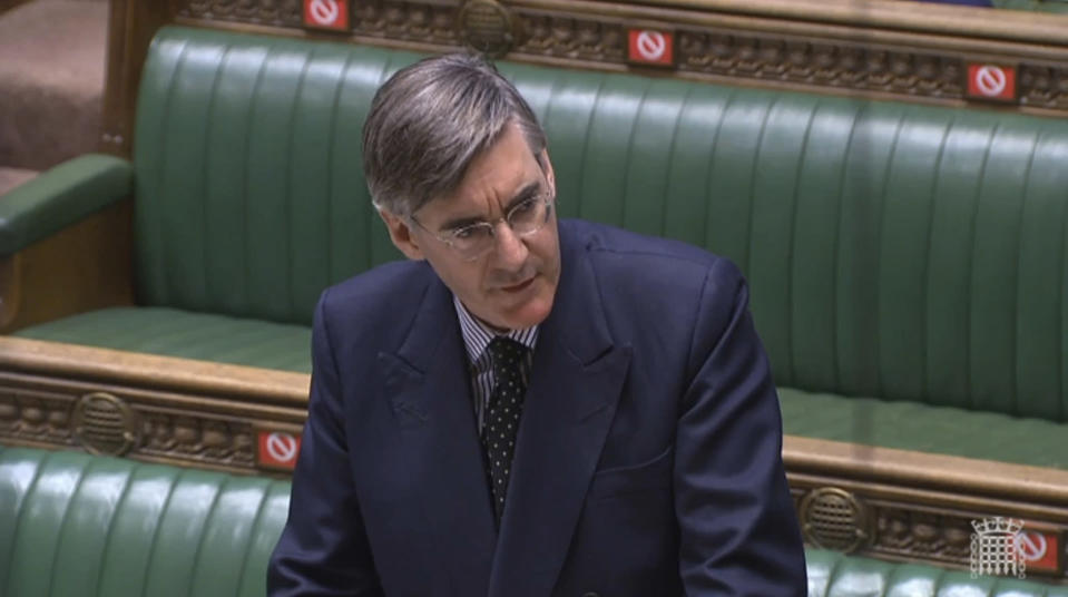 In this grab taken from video provided by the House of Commons, Leader of the House Jacob Rees Mogg answers questions in the House of Commons, during a motion on parliamentary proceedings during the coronavirus outbreak, in London, Tuesday June 2, 2020. Like many other Britons, U.K. lawmakers have largely been working from home during the coronavirus pandemic. Now they are being summoned back to the office and many aren't happy. They say the government's decision to scrap a remote-voting system used during the pandemic will turn those who must stay home because of age, illness or family issues into second-class lawmakers. (House of Commons via AP)
