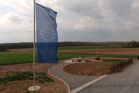 A European flag flutters near a red-white pole, marking the new geographical centre of the European Union in case of Brexit in Gadheim, Germany, April 8, 2019. REUTERS/Tilman Blasshofer/Files