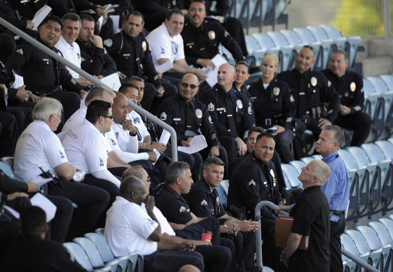 Los Angeles Police Department officers and members of Dodger Stadium security listen in on a meeting at Dodger Stadium prior to the Dodgers' Major League Baseball game against the St. Louis Cardinals, Thursday, April 14, 2011, in Los Angeles. Bryan Stow, the father of two, was beaten in a parking lot outside Dodger Stadium after the teams' March 31 season opener and remains hospitalized in Los Angeles in a medically induced coma. (AP Photo/Mark J. Terrill)