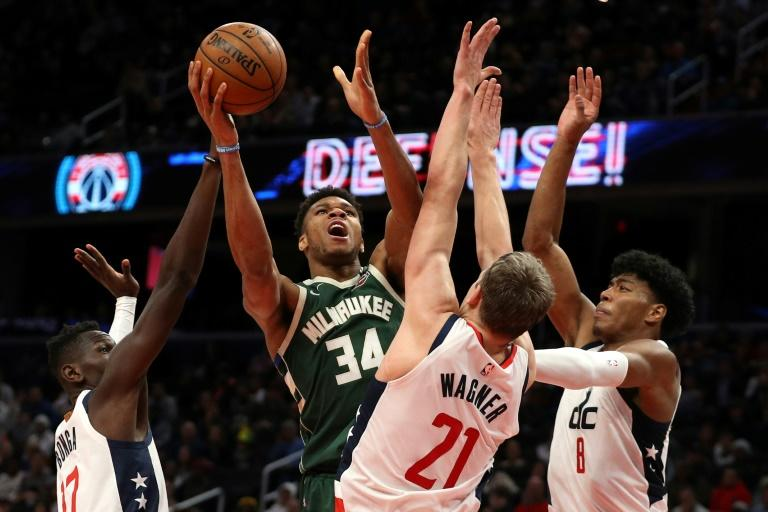 Milwaukee's Giannis Antetokounmpo shoots in front of Moritz Wagner, Isaac Bonga and Rui Hachimura of the Washington Wizards in the Bucks' 137-134 overtime victory (AFP Photo/Patrick Smith)