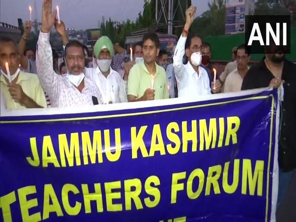 Jammu and Kashmir Teachers forum holding a candle march protest against the selective killing in the valley. (Photo/ANI)