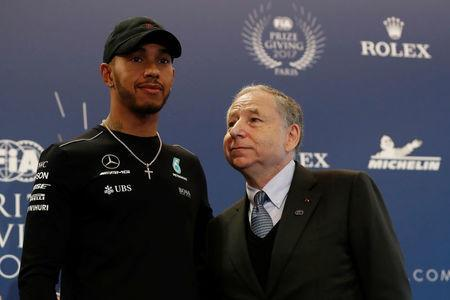 Mercedes' Formula One driver Lewis Hamilton (L) and Jean Todt, Federation Internationale de l'Automobile (FIA) President attend the FIA Champions news conference for FIA Prize Giving 2017 in Paris, France December 8, 2017. REUTERS/Gonzalo Fuentes