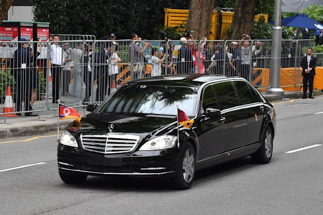 <p>A motorcade transporting North Korea's leader Kim Jong Un sets off to Sentosa, the resort island where Kim is scheduled to meet with US President Donald Trump for a US-North Korea summit, from his hotel in Singapore on June 12, 2018. – Donald Trump and Kim Jong Un will make history on June 12, becoming the first sitting US and North Korean leaders to meet, shake hands and negotiate to end a decades-old nuclear stand-off. (Photo: Adek Berry/AFP/Getty Images) </p>
