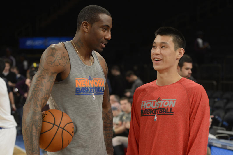 Houston Rockets' Jeremy Lin, right, talks to former New York Knicks teammate Amare Stoudemire before an NBA basketball game at Madison Square Garden in New York, Monday, Dec. 17, 2012. The game marks Lin's return to New York after leaving in the offseason. (AP Photo/Henny Ray Abrams)