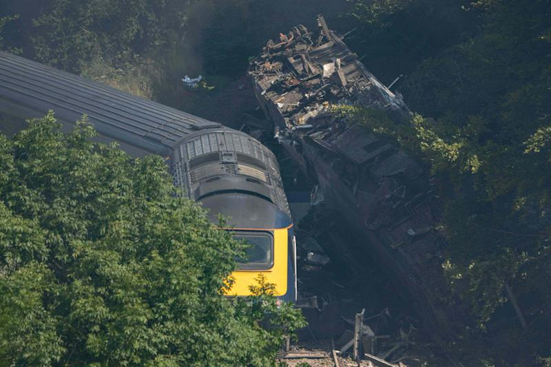 Derailed carriages are seen at the scene of the deadly train crash (AFP via Getty Images)