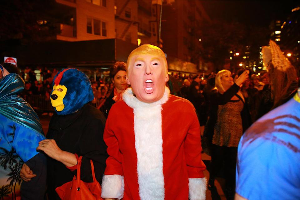 <p>A man wears a Donald Trump mask and a Santa suit at the 44th annual Village Halloween Parade in New York City on Oct. 31, 2017. (Photo: Gordon Donovan/Yahoo News) </p>