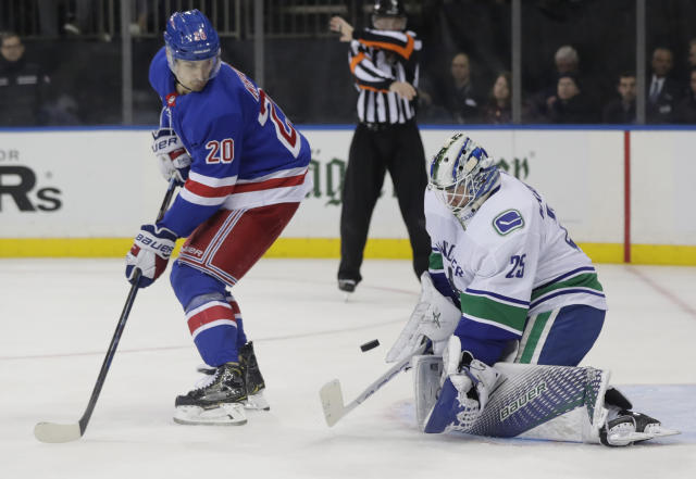 Vancouver Canucks goaltender Jacob Markstrom (25) stops a shot on the goal as New York Rangers' Chris Kreider (20) watches during the second period of an NHL hockey game Monday, Nov. 12, 2018, in New York. (AP Photo/Frank Franklin II)