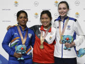 <p>Tejaswini Sawant of India, left, silver medal, Martina Lindsay Veloso of Singapore, center, gold medal, and Seonaid McIntosh of Scotland, right, bronze medal, stand on the podium during the women's 50m Rifle Prone final at the Belmont Shooting Centre during the 2018 Commonwealth Games in Brisbane, Australia, Thursday, April 12, 2018. (AP Photo/Tertius Pickard) </p>