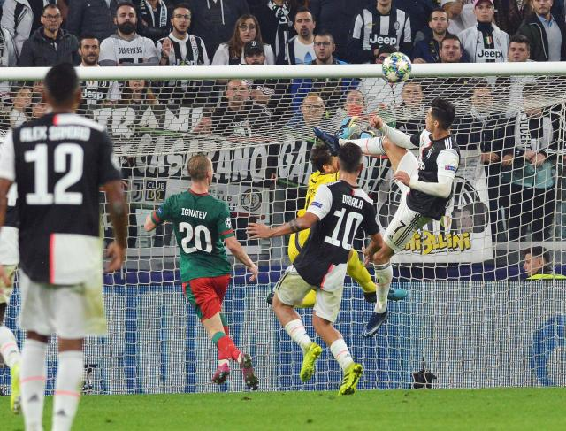 Juventus' Cristiano Ronaldo, right, jumps for the ball during the UEFA Champions League group D soccer match against Lokomotiv Moscow at the Allianz Stadium in Turin, Italy, Tuesday, Oct. 22, 2019. (Andrea Di Marco/ANSA via AP)