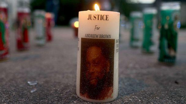 PHOTO: A lite candle in a memorial built to honor Andrew Brown Jr, May 1, 2021, in Elizabeth City, North Carolina. (Joe Raedle/Getty Images)